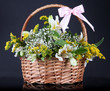Bouquet of flowers in basket isolated on black