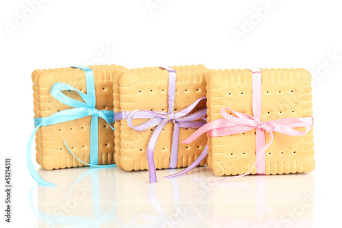 Sweet cookies tied with colorful ribbons isolated on white