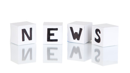 """White paper cubes labeled """"News"""" isolated on white"""