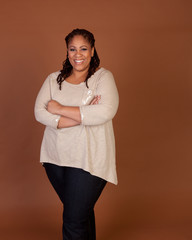 Confident Plus Size Woman standing with Arms Folded