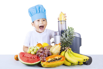 Boy making healthy juice - isolated