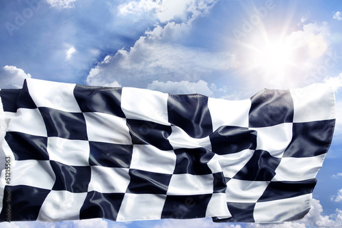 Checkered flag in bright sky