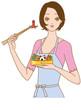 料理する女性 キャラ弁を作る
