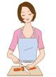 料理する女性 包丁ニンジンを切る