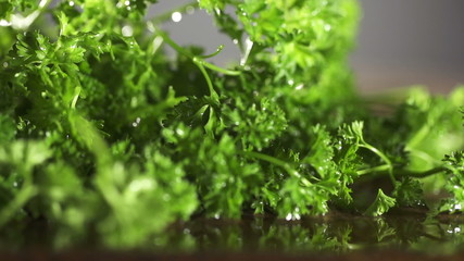 Fresh organic parsley with knife on wooden cutting board. Macro