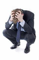 Stressed businessman with hands in his hair