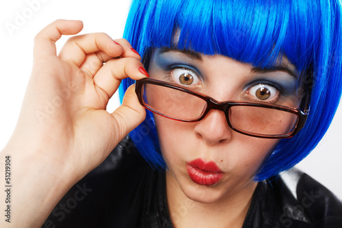 girl with blue wig looking astonished