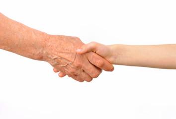 Generations - grandmother and grandchild handshake