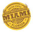 Grunge color stamp with text Greetings from Miami, vector