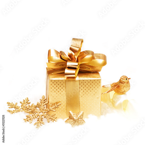 Gold gift with christmas decoration