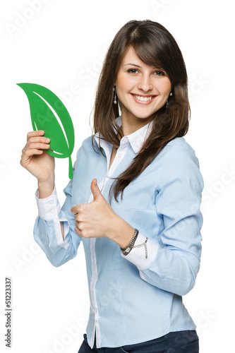 Woman holding eco leaf and showing thumb up sign