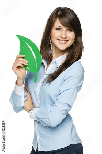 Happy young woman holding eco leaf