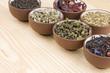 Assortment of dry tea in ceramic bowls