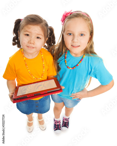 Best friends with digital tablet