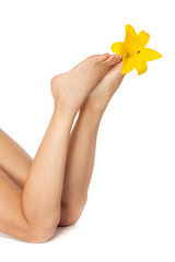 Beautiful woman legs with flower , isolated on white