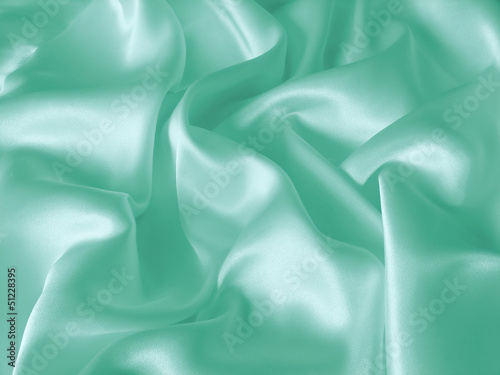 Draped turquoise silk background