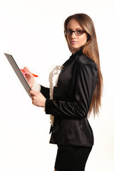 Beautiful young business woman with clipboard isolated in white