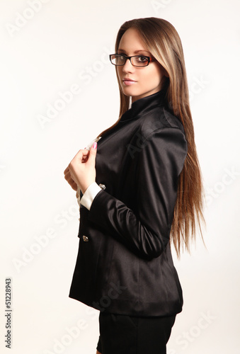 Cute young business woman isolated in white background