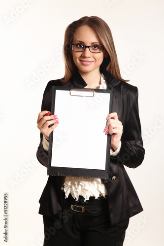Cute young business woman with clipboard isolated in white backg