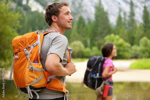 Hikers - people hiking, man looking in Yosemite