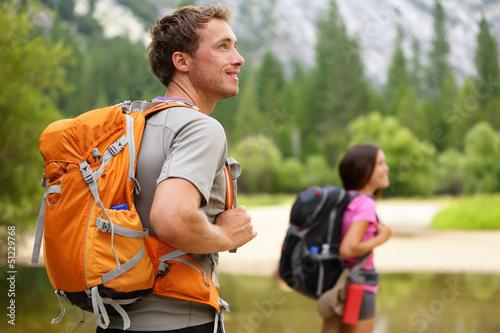 Leinwanddruck Bild Hikers - people hiking, man looking in Yosemite