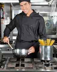 Happy Chef Preparing Pasta