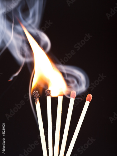 Burning matches on a black background