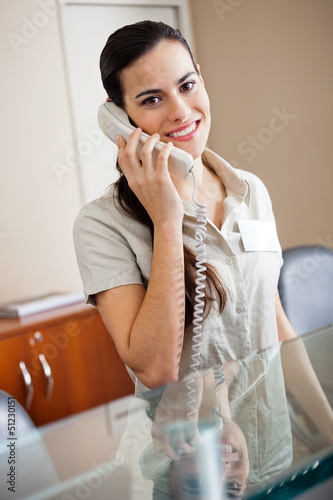 Female Receptionist Attending Call