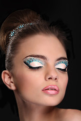 Portrait of beautiful young girl with fashion make-up isolated o