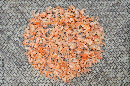 Dried shrimp on bamboo background