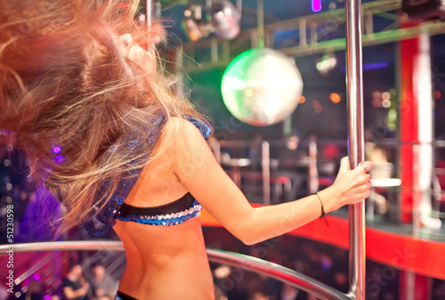 Woman dancing in the nightclub.