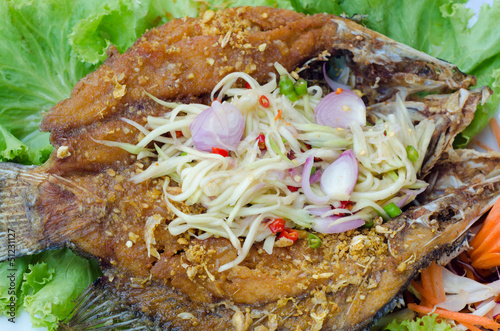 Tilapia fish fried  with mango salad