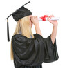 Woman in graduation gown looking into distance through diploma
