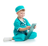 Child boy uniformed as doctor writing to clipboard isolated on