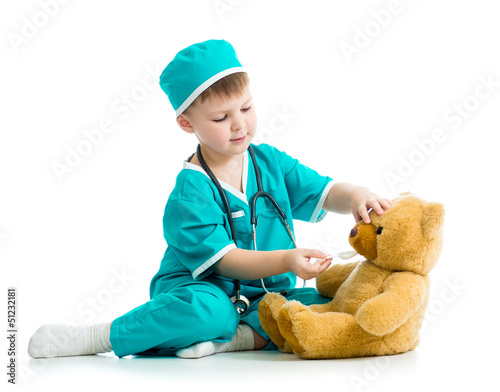 boy kid playing doctor with plush toy