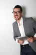 Cheerful salesman using digital tablet
