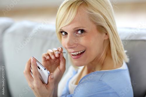 Beautiful smiling woman using smartphone