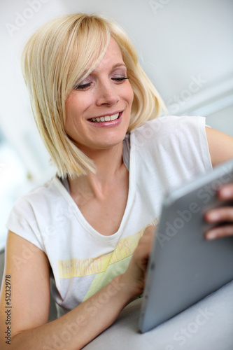 Beautiful smiling woman using digital tablet
