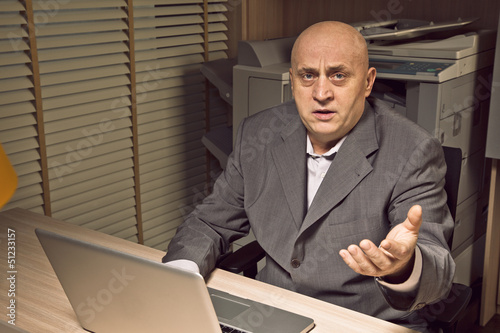 angry businessman working at night