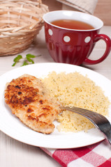 Breaded chicken cutlets with couscous