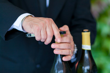 waiter opening a bottle of white wine