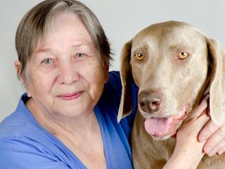 Senior happy woman and dog