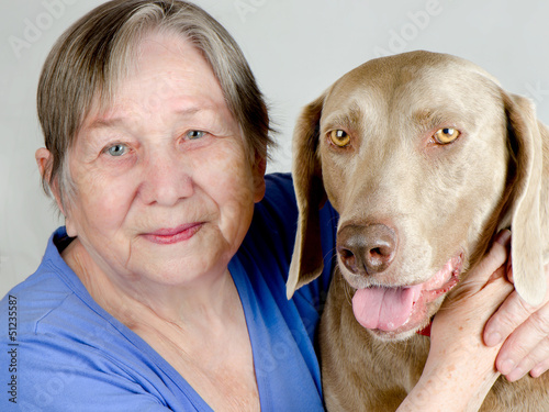 Senior happy woman and dog
