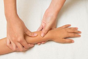 children massage with morther hand