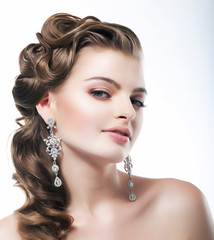 Delight. Posh Woman with Diamond Earrings. Platinum Jewelry