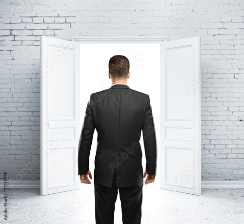 man and open door