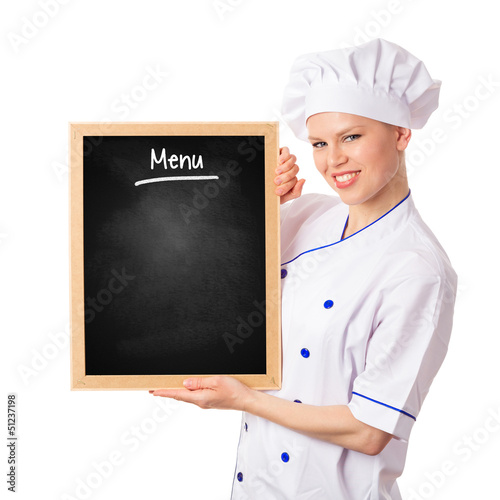 Pretty smiling chef woman holding menu blackboard