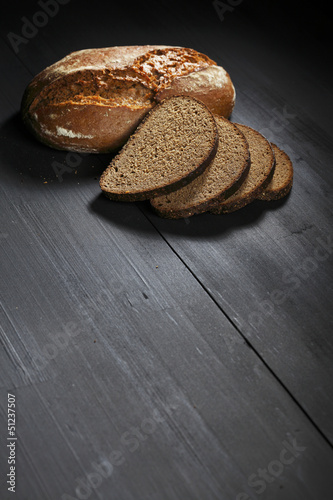 Sliced black bread on wooden table