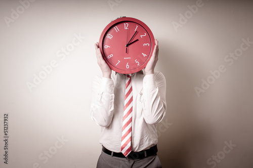 funny businessman with wall clock