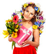 Woman with gift box and flower.